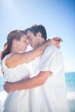 Happy couple hugging eyes closed Stock Photo