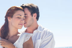 Happy couple hugging eyes closed stock images
