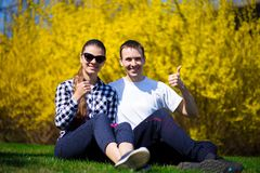 Happy couple hugging on fresh grass in park royalty free stock photos