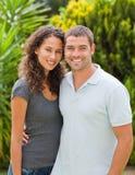 Happy couple hugging in the garden Stock Photo