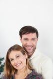Happy couple hugging himself beside the christmas tree Stock Photography