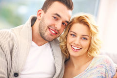 Happy couple hugging at home Stock Image