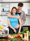 Happy couple hugging in the kitchen Royalty Free Stock Images