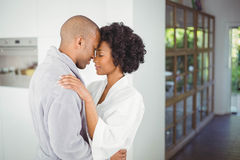 Happy couple hugging in the kitchen Stock Photography