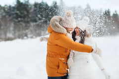 Happy couple hugging and laughing in winter Royalty Free Stock Photo