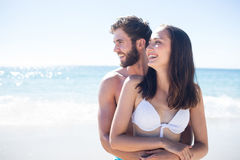 Happy couple hugging and looking away Royalty Free Stock Photo