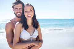Happy couple hugging and looking at camera Stock Image