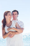 Happy couple hugging and looking at camera Royalty Free Stock Photo