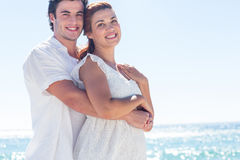 Happy couple hugging and looking at camera Royalty Free Stock Photography