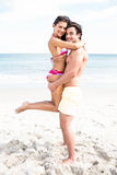 Happy couple hugging and looking at camera Royalty Free Stock Image