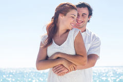 Happy couple hugging and looking at each other Royalty Free Stock Image