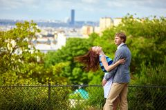 Happy couple is hugging on Montmartre Stock Images