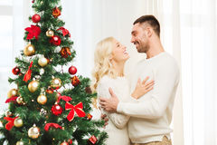Happy couple hugging near christmas tree at home Royalty Free Stock Photography