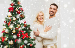 Happy couple hugging near christmas tree at home Royalty Free Stock Image