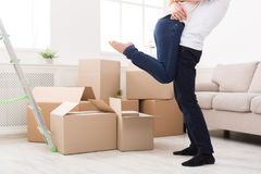 Happy couple hugging near unpacked boxes Stock Photo