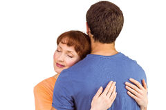 Happy couple hugging one another Royalty Free Stock Image