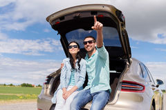 Happy couple hugging at open hatchback car trunk Royalty Free Stock Images