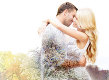 Happy couple hugging over cherry blossom Royalty Free Stock Photos