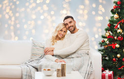 Happy couple hugging over christmas tree Royalty Free Stock Photo