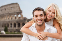 Happy couple hugging over coliseum Royalty Free Stock Photos