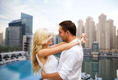 Happy couple hugging over dubai city background Royalty Free Stock Image