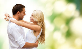 Happy couple hugging over green background Royalty Free Stock Photography
