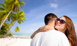 Happy couple hugging over tropical beach Royalty Free Stock Photo