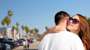 Happy couple hugging over venice beach stock photography
