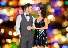 Happy couple hugging at party over festive lights Stock Photos