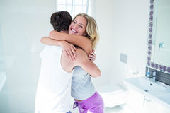 Happy couple hugging with positive pregnancy test Stock Images