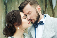 Happy couple hugging on rock on the background of nature Stock Photography