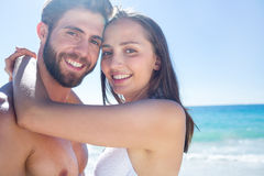 Happy couple hugging and smiling at camera Stock Photography