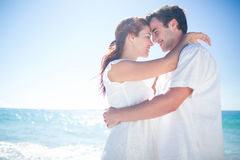 Happy couple hugging and smiling at each other Royalty Free Stock Image