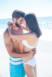 Happy couple hugging and smiling at each other Royalty Free Stock Photography
