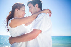 Happy couple hugging and smiling at each other Stock Image