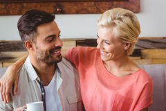 Happy couple hugging and smiling at each other Royalty Free Stock Images