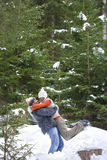 Happy couple hugging in snowy woods Stock Photos