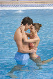 Happy couple hugging in swimming pool Royalty Free Stock Images