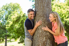 Happy couple hugging a tree Stock Photography