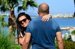 Happy  couple hugging. Happy couple hugging  on tropical garden near the sea Royalty Free Stock Photo