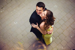 Happy couple hugs and looks up in the sky Stock Photos