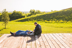 Happy couple - Husband and his pregnant wife relaxing in autumn nature.  Royalty Free Stock Images