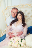 Happy Couple: husband and pregnant wife waiting for baby Stock Image