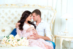 Happy Couple: husband and pregnant wife waiting for baby.  stock photos