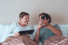 Happy couple, husband and wife in bedroom Stock Photography