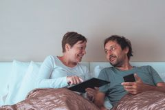 Happy couple, husband and wife in bedroom Royalty Free Stock Photography