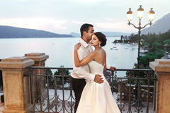 Happy couple husband and wife hugging at balcony in evening near Royalty Free Stock Photo