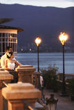 Happy couple husband and wife hugging at balcony in evening near. Sea Stock Images