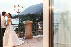 Happy couple husband and wife hugging at balcony in evening near Royalty Free Stock Image