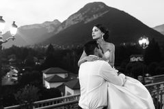Happy couple husband and wife hugging at balcony in evening near. Sea b&w Stock Image